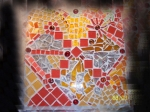'Tana's Sunshine' with cut glass, ceramic, china, glass stones and tiles.